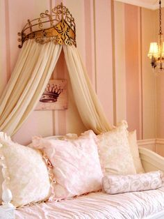 Soft shades of pink create a restful backdrop while a golden bed crown and diminutive chandelier add fun, dramatic accents to this 3-year-old's princess room. RMSer ajerde chose furnishings, like the daybed, that tastefully fit the room's princess theme but will grow with her child.