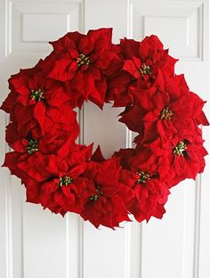 DIY Christmas Poinsettia Wreath. Idea: make a large one and hang around my round mirror over my mantle. :)