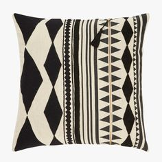 Tribal influences abound in this unique Black Embroidery Zipper Pillow designed by Nikki Chu. Featuring black tribal inspired embroidery.