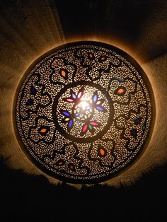 Outstanding moroccan wall sconce, light with its remarkable openwork pattern. Moroccan Interior Design.