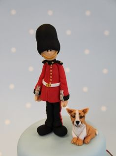 Adorable Queen's Guard and Corgi cake toppers perfect for the Queen's 90th birthday celebrations! Find out how to model these figures with Jan Clement-May at Squires Kitchen.