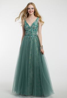 You are sure to make an enchanting entrance in this ball gown prom dress! The deep v-neckline, fitted beaded bodice, tulle ball gown skirt, and v-back give this evening gown a magical touch. #CLVprom17 #camillelavie