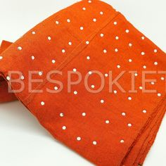 Spring has sprung and it is looking beautiful . Handwoven fabric Metallic Orange Aso oke with diamante stones from @bespokiet  Available as a set / gele / aso ebi order .