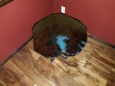 """This unique live-edge end table is crafted out of redwood and set on metal legs. This burl has a one of a kind look. Deep, rich color with lots of figure and flame make this a stand out for home or office. Epoxy finish with blue highlights. The table is roughly 26"""" to 28"""" across and 23.5"""" high.   Here at Nature Made Products, we want to hear your ideas. We offer custom live-edge tables are available upon request. Lodge Furniture, Custom Furniture, Redwood Burl, Blue Highlights, Live Edge Table, Custom Wood, Wood Table, Epoxy, End Tables"""