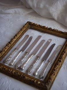 What a beautiful idea- displaying vintage cutlery etc in a photo frame in the kitchen!    french mix vintage knives