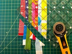 """To cut the pieces of the star sections, I just moved the ruler up the strip by 1"""" and cut again. My ruler has little white lines running par..."""