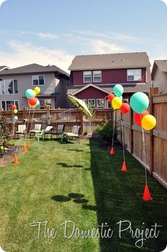Construction cones to hold balloons! Such a cute idea!