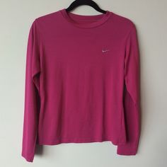 Nike Dri-Fit long sleeve active top Nike Dri-fit Long sleeve Active top Preowned- excellent condition. Made of 100% polyester Size Medium Measurements: underarm to underarm is approximately 19 inches flat across. Back of neck to bottom of hem is approximately 23 inches. Nike Tops Tees - Long Sleeve