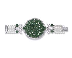AN EXQUISITE ART DECO EMERALD AND DIAMOND BRACELET, BY CARTIER Of Indian design, centering upon a cabochon emerald plaque of circular outline, with single-cut diamond trim, flanked on either side by old European-cut diamond trefoil shoulders to the cabochon emerald and four-row cultured pearl bracelet, measuring approximately 4.50 mm, joined by a circular and rectangular-cut diamond clasp, mounted in platinum and gold, circa 1934,