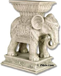 Indian Elephant Pedestal Table - Elephant in table with Indian style design. Makes a perfect little in table at the end of the couch or out on a patio or deck. Will take the outside weather with several finish options available