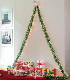 A lot of x-mas ideas ... this garland tree is such a great idea