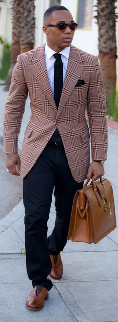 Shop this look on Lookastic:  https://lookastic.com/men/looks/blazer-dress-shirt-chinos-brogues-briefcase-tie-pocket-square/1790  — Navy Knit Tie  — White Dress Shirt  — Navy Chinos  — Brown Leather Brogues  — Brown Leather Briefcase  — Tan Plaid Blazer  — Navy Cotton Pocket Square