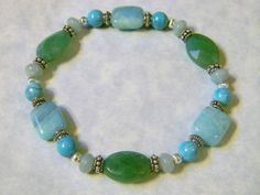 Stretch bracelet with three shades of amazonite beads, in 10 x 12mm rectangles, 10 x 14mm flat ovals and 4 x 6mm spacers, 6mm turquoise rounds and Bali style silver spacers and corrugated silver round