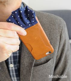 Teaming up with J.Crew, Tonight Show host Jimmy Fallon created an iPhone 6/6S leather case call The Pocket Dial, with a removable pocket square clip