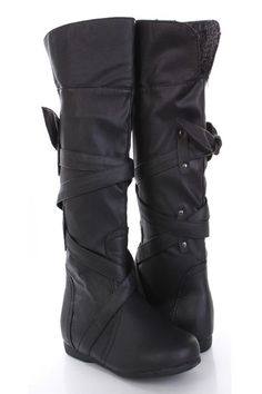 A fresh spin on a classic shape, these boots will be a fun addition to your shoe wardrobe! They will look super hot paired with your favorite skinnies or dress. So make sure you add these to your closet, it definitely is a must have! The features include faux leather upper with wrap around strap design, round closed toe, faux shearing inner trim, stitched detailing, slip on design, smooth lining, and cushioned footbed. Approximately 15 inch circumference and 15 inch shaft.