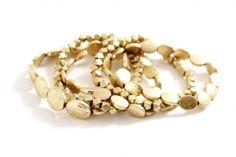 Set of five gold stretch bracelets by www.karenegren.com
