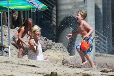 Tori Spelliing takes her kids Liam, Stella, Hattie and Finn to the beach on August 16, 2014