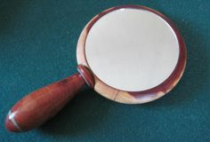 Custom artist crafted hand mirrors.  The perfect gift for anyone on your list.