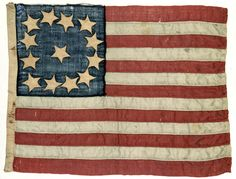 June 14, 1777: United States adopts its flag, by resolution of the Second Continental Congress. Thirteen Star American Flag, wool, cotton, 1830-1880; found in the Old Porter house, Nelsonville, Putnam County, New York. NYHS Object Number 1939.559.