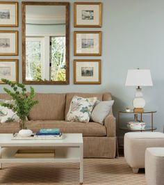 Neutral living room + cream square ottomans + taupe linen sofa + unique gallery wall above couch + white coffee table + metal side table + neutral area rug Blue Couch Living Room, Living Room Decor, Living Room Wall Decor Ideas Above Couch, Living Room With Mirror, Decor Above Sofa, Gallery Wall Living Room Couch, Blue And Cream Living Room, Mirror Above Couch, Living Area