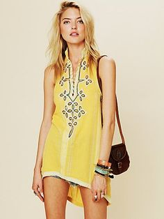 A sleeveless yellow tunic that can easily go from the beach to the ...