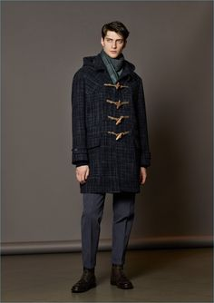 Front and center, Matthew Bell sports a graphic duffle coat from Boglioli.