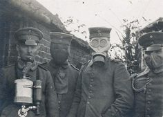 German soldiers wearing four different types of gas masks that were used in the…