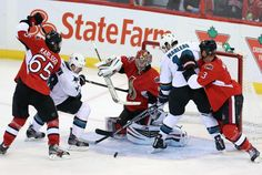 San Jose Sharks forwards Mike Brown + Patrick Marleau crash the Ottawa Senators net (Oct. 27, 2013).
