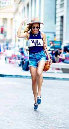 Jamie Chung of What The Chung wearing denim cutoffs with a tucked in tank, lace-up espadrilles, and a panama hat