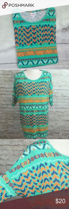"""LuLaRoe Abstract Geometric Print Irma Tunic Top LuLaRoe ~ Abstract Geometric Print Irma Top. Size Small, In Good Pre-Owned Condition.  Armpit to Armpit 25"""" Length 27"""" Front / 32"""" Back  Elbow Sleeve Multi-Color  Polyester & Spandex   No Trades, Offers Welcome! Thanks For Looking! LuLaRoe Tops Tunics"""