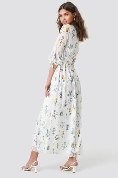 This maxi dress by Kae Sutherland x NA-KD features a v neckline, a waistband, a self tie closure on the sleeves, a floral print, an inner slip dress and a flowy fit. Stylish Dresses, Cute Dresses, White Maxi Dresses, White Dress, Buy Dress, Jean Outfits, Custom Clothes, Dresses Online, What To Wear