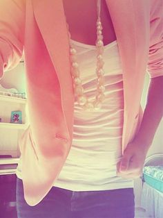 peach blazer, white tank, and pearls