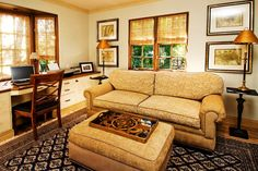 Combining a home office with Den/Sofa sleeper maximizes a rooms tasks. A traditional home office by Debra Campbell Design