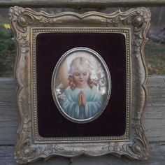 Here is a vintage Art  Nouveau, gold gilt, gesso frame with a print of a little girl praying.  This beautiful frame measures seven inches tall by six  offered by Ruby Lane shop Saltymaggie's Treasures
