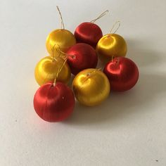 Gold and red mini foam ornaments  https://www.etsy.com/listing/478360669/lot-of-8-vintage-red-and-gold-satin-foam