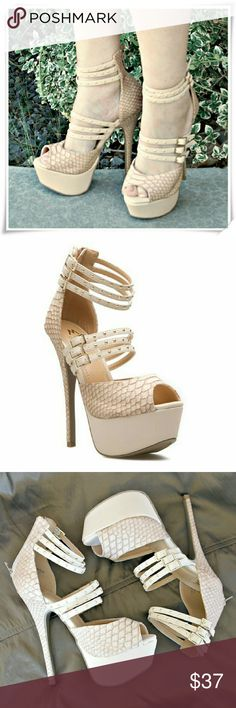 Sadia strappy sandals booties heels. SD Madison line. The shoe features sky high heel, 2 different materials ' nubuck like beige faux leather, and  reptilian material. 6 adjustable straps with gold studs. Back zip clouser. I'd  recommend to losen upper st
