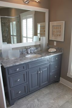 color cabinet, glass knobs, marble counter