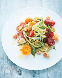 """Zucchini """"Pasta"""" Produce 2 tbsp Basil, fresh 8 oz Cherry tomatoes 1 clove Garlic 1 Zucchini, thinly sliced lengthwise, slices cut into 1/4-inch-long strips Baking & Spices 1 Sea salt Oils & Vinegars 2 tbsp Olive oil, extra-virgin Nuts & Seeds 1/4 cup Walnuts, raw"""