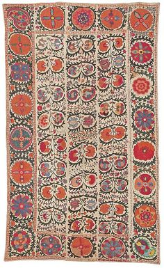 Suzani Rug, a type of antique embroidered textile produced in Kazakhstan, Tajikistan and Uzbekistan. They are embroidered and then multiple pieces are stitched together. Usually the motifs used are the botah motif and other flowers such as tulips, wild hyacinths and pomegranate blossoms. Suzani derives from the Persian word for needle and to the coverings and embroidered hangings.