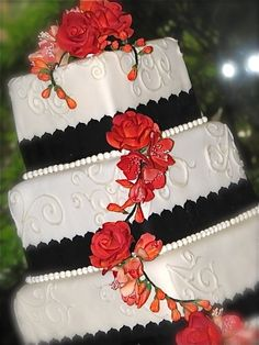 Very elegant white, navy, and coral Wedding Cake