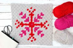 This free c2c crochet graph makes a graphic, modern, monochromatic snowflake. Crochet several for a bright, happy winter afghan or check out the rest of the Christmas corner-to-corner patterns to make a sampler afghan.