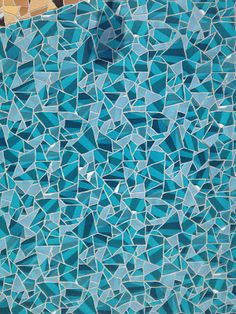 Detail view of Apple Store tile mosaic in Barcelona using colors from the App Store iOS app icon
