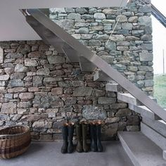 grey-stair-case-with-stone-wall