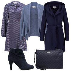 Per questo outfit: vestito fantasia con fiocco al collo, cardigan azzurro che riprende il vestito, cappottino blu con cappuccio, tronchetti blu e pochette blu.
