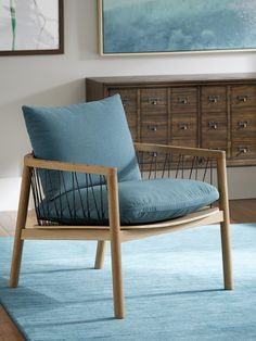 The Lacing chair just might steal the show with its subtle pop of color and attractive mid-century feel. #CORTatHome #homedecor #teal