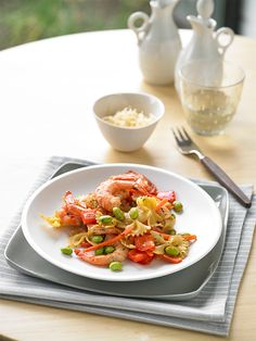 Busy days don't have to mean fast food for dinner. Whip up this shrimp and veggie pasta and skip the drive-thru line. Plus enjoy guilt free. One serving is only 310 calories.