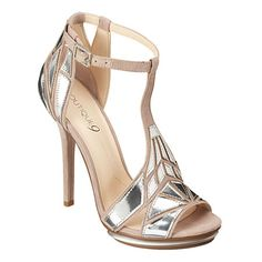 """As seen in the December issue of People Style Watch & the February issue of Cosmo.....Art deco inspired t-strap sandal.  Metallic accents and Island platform.  Adjustable buckle closure.  Measurements: heel 4 3/4 and platform 3/4""""."""