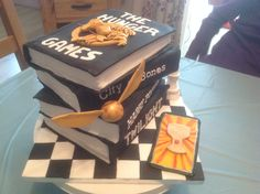 Fandom, hunger games, mortal instruments, twilight, Harry Potter book cake