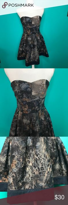 """Lucca Couture Animal print strapless dress This dress is so gorgeous and the print is so unique! Animal print with a jacquard navy blue trim. The material is almost like a soft heavy denim. Strapless sweetheart cut.  25"""" from top of bust to hem Lucca Couture Dresses Mini"""