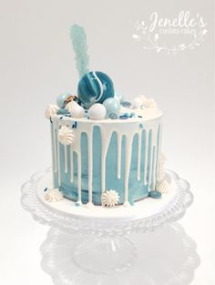 Blue drip cake. By Jenelle's Custom Cakes.